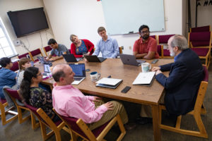 Trace faculty and students meet around a conference table